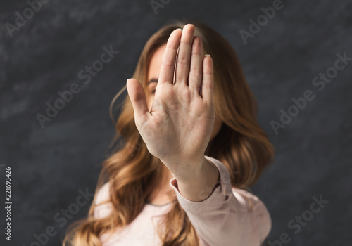 Woman showing stop sigh with her hand