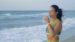 Slow Motion, Beautiful Woman Standing on the Sea Shore and Drinking Water After Morning Jogging
