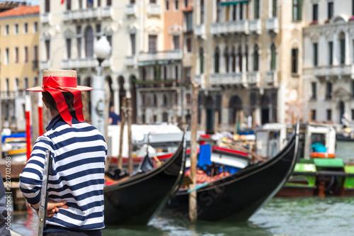 Fotografie, Obraz  Gondolier standing next to gondola waiting for a client