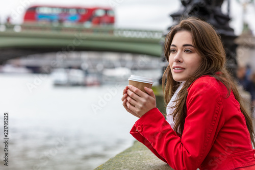 Foto op Canvas Londen rode bus Woman Drinking Coffee by Westminster Bridge, London, England