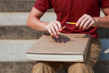 Pencil Or Pen Tapping Student Using Two Pencils And A Text Book