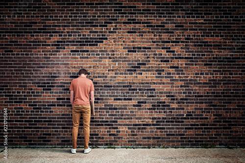 Student blending into brick wall Canvas Print