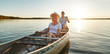 canvas print picture - Smiling young couple canoeing together on a lake in summer