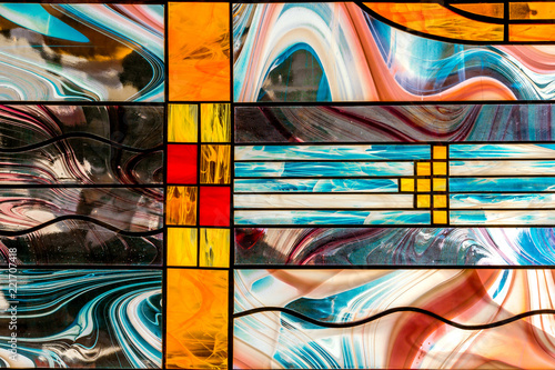 Fotografie, Obraz image of a multicolored stained glass window with an irregular block pattern, an