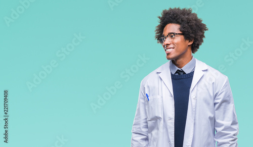 Fotografia  Afro american doctor scientist man over isolated background looking away to side with smile on face, natural expression