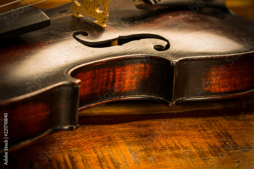 Fototapeta Old violin in vintage style on wood background
