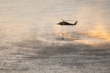 Helicopter In Plumes Of Water ...