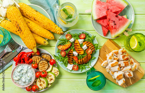Grill, Barbecue Summer bbq party concept - grilled chicken, vegetables, corn, salad, top view, copy space