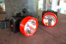 LED Headlamp. The Small Flashlight With Straps For Head