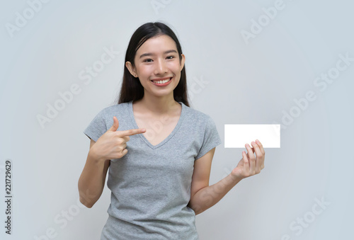 Fotografering  Asian woman holding empty blank billboard paper sign board, Advertising banner s