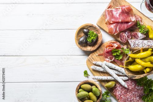 Italian antipasto with salami, jamon and olives on white. Canvas Print