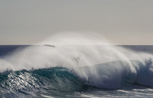 A Surfer Falls Into The Wave