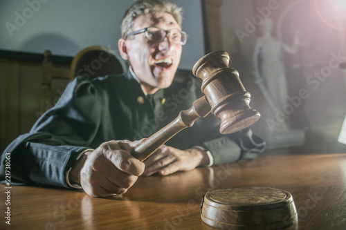 judge with a hammer in his hand in the court room Canvas Print