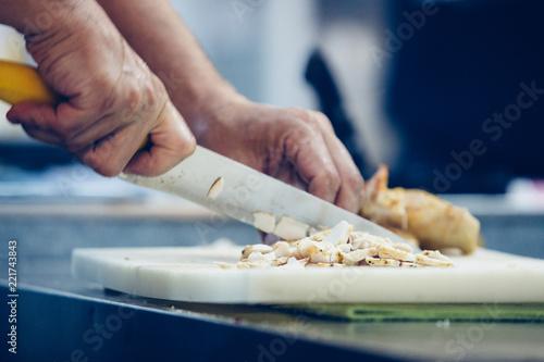 Preparing chicken for spanish tapas
