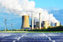 Clean Energy Generated By Solar Panels Station And Windmills Versus Conventional Energy With Fuel Coal Power Plant