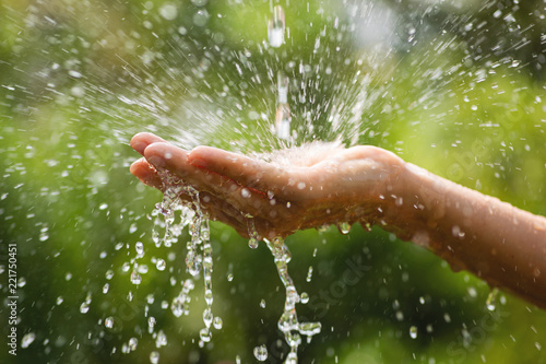 Fotografie, Obraz  Wet female hands and clear water splashes