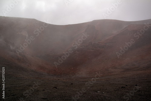 Spoed Foto op Canvas Chocoladebruin Etna vulcano surrealistic landscape mountain clouds fog lava stone
