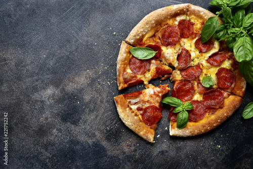 Traditional italian pizza pepperoni with salami and cheese.Top view with copy space.