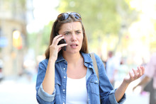 Confused Woman Having A Phone Conversation