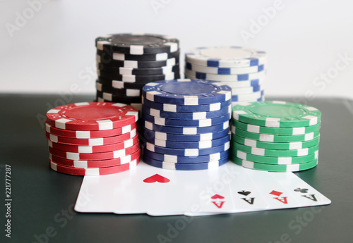 фотография  The pile of casino chips with cards.