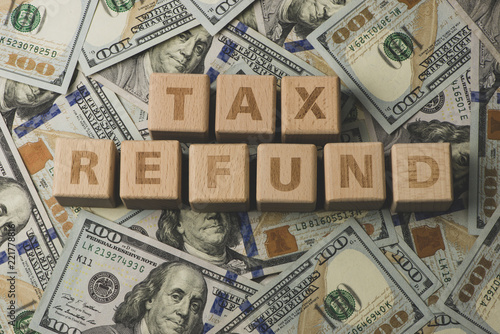 Tax Refund concepts  Tax Refund characters and US currency notes