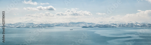 View of Avacha Bay covered with ice, volcanoes and snow-covered hills in Petropa Canvas Print