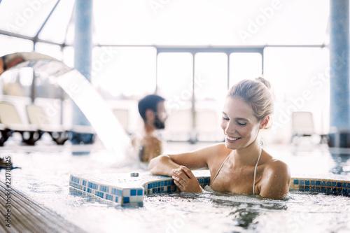 Obraz Portrait of beautiful woman relaxing in swimming pool - fototapety do salonu
