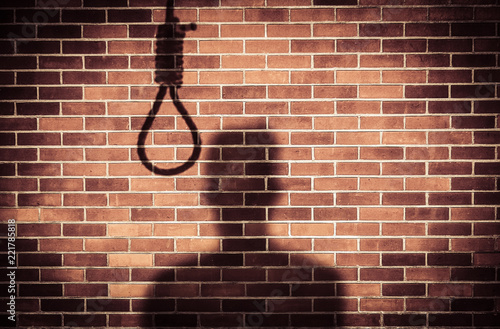 Fotografie, Obraz  shadow of a sad man with hangman noose on wall while making decision to suicide