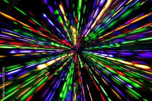 Fotografia, Obraz  Diagonal blurred lines of color lights is converged on dark background