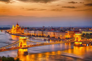 Fototapeta na wymiar Budapest city night scene. View at Chain bridge, river Danube and famous building of Parliament
