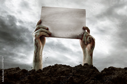 Obraz na plátne Zombie hands holding blank sign