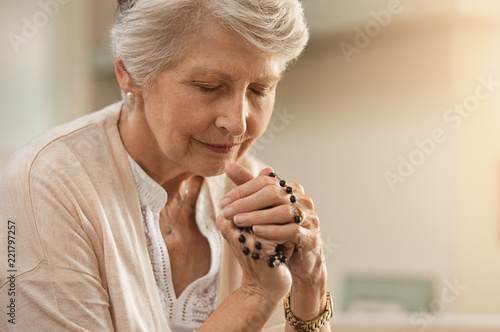 Senior woman praying