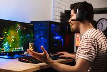Image Of Cheerful Gamer Man Pl...