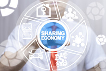 Man Clicks A Sharing Economy Text Button On A Virtual Display. Sharing Economy Business Financial Concept.