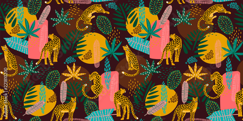 Obraz na plátně Vestor seamless pattern with leopards and tropical leaves.