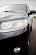 Black modern car closeup. Black modern car headlights - front vi