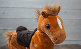 a beautiful red horse with a saddle kid toy