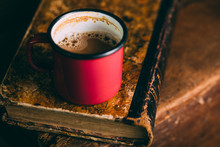 Enamel Cup Of Coffee On A Rustic Wooden Background