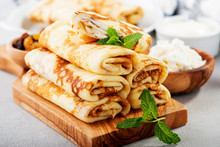 Thin Pancakes Stuffed With Cottage Cheese And Raisins.