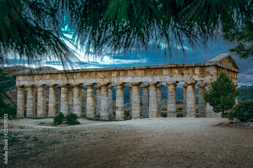 Fotografie, Obraz  The ruins of the Greek temple at sunset in the ancient city of Segesta, Sicily,