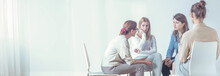 Women Listening To A Therapist During A Session. Empty Space, Place Your Poster