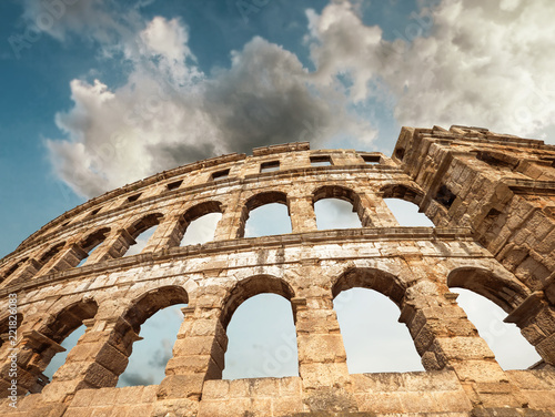 Spoed Foto op Canvas Theater Pula Amphitheatre with white clouds sky, Istria, Croatia