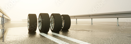 Fényképezés  Reifen auf Fahrbahn bei Regen Wetter