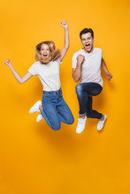 Young Loving Couple Jumping Is...