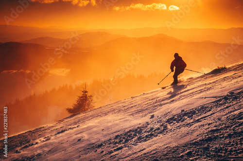 Silhouette of a skier on the hill. Sport and active life