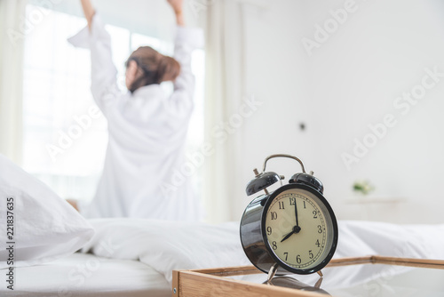 Young woman lying in bed in morning Wallpaper Mural