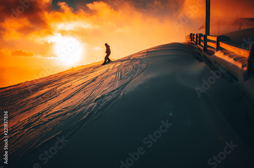 Silhouette of a snowboarder on the hill. Sport and active life. Winter Christmas time, edit space