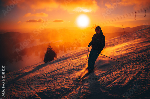 DONOVALY, SLOVAKIA, 5. JANUARY, 2017: Skier in Jasna ski resort, sunset light in background