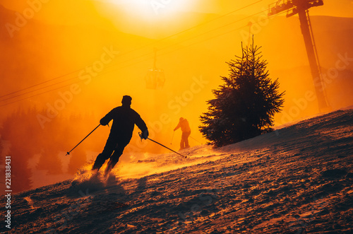 Skier silhouette in sunset light