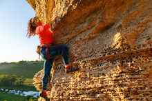 Pcture Of Curly-haired Climber Girl Climbing Rock